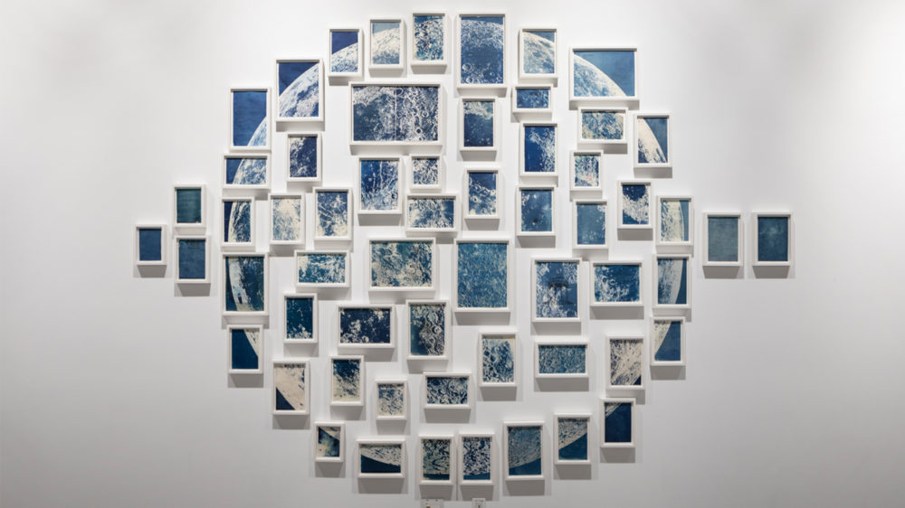 Ala Ebtekar, Thirty-six Views of the Moon, 2019, 59 individual cyanotypes on found book pages exposed to moonlight, dimensions variable. Spring 2019 edition. McEvoy Family Collection. Courtesy of the artist and The Third Line.