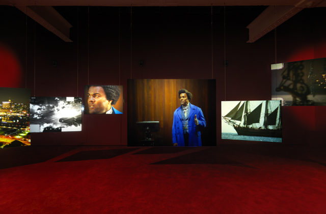 Isaac Julien Lessons of the Hour, 2019 (installation view, detail) Ten-screen installation 35mm film and 4k digital, color, 7.1 surround sound. 28'46'' Courtesy of the artist and Metro Pictures, New York