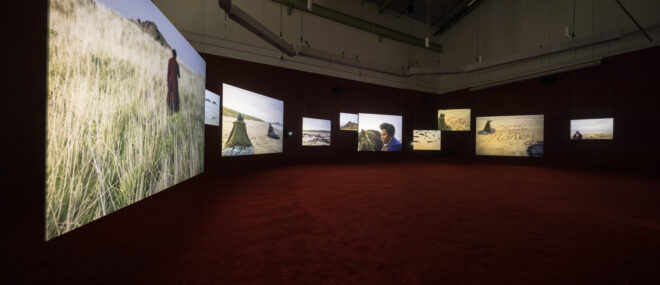 Isaac Julien, Lessons of the Hour, 2019 (installation view). ten-screen installation, 35mm film and 4k digital, color, 7.1 surround sound. 28 min. 46 sec. Courtesy of the artist and McEvoy Foundation for the Arts, San Francisco. Photo by Henrik Kam