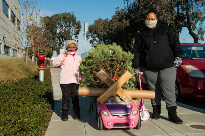 Attendees of the NOW Hunters Point Christmas Tree giveaway receive their Erica Deeman: In Our LIkeness MCD Mobile MakeArt Kits, December 19, 2020. Courtesy of McEvoy Arts and the Museum of Craft and Design. Photo by Pat Mazzera